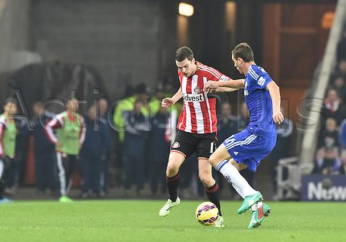 29.11.2014.  Sunderland, England. Premier League. Sunderland versus Chelsea. Nemanja Matic of Chelsea under pressure from Adam Johnson of Sunderland
