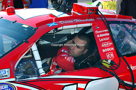 Dario Franchitti strapping himself into race car #42 at the NASCAR race Memphis Motorsports Park 2007.