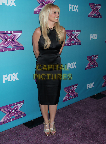 Britney Spears.'The X Factor' season finale press conference at CBS Studios, Los Angeles, California, USA..December 17th, 2012.full length black sleeveless dress silver sandals shoes profile .CAP/ADM/RE.©Russ Elliot/AdMedia/Capital Pictures.