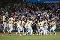 Vanderbilt Commodores celebrate beating the Michigan Wolverines in Game 3 of the NCAA College World Series Finals on June 26, 2019 at TD Ameritrade Park in Omaha, Nebraska. Vanderbilt defeated Michigan 8-2 to win the National Championship. (Andrew Woolley/Four Seam Images)