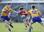 Ross Nally of Louth  in action against Conal O hAinifein and Sean Collins of Clare during their national League game in Cusack Park. Photograph by John Kelly.