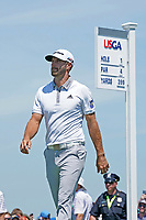 Dustin Johnson (USA) walks off the first tee during his final round of the 118th U.S. Open Championship at Shinnecock Hills Golf Club in Southampton, NY, USA. 17th June 2018.<br /> Picture: Golffile | Brian Spurlock<br /> <br /> <br /> All photo usage must carry mandatory copyright credit (&copy; Golffile | Brian Spurlock)