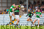 Jamie O'Sullivan Legion punches the ball away from David Niblock Nemo Rangers during the AIB Munster club SFC clash in Pairc Uí Rinn on Sunday