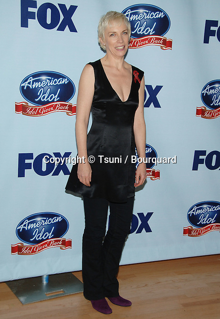 Annie Lennox  at the American idol Gives Back Press Room at the Disney Hall in Los Angeles.<br /> <br /> full length<br /> eye contact<br /> smile