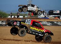 Apr 16, 2011; Surprise, AZ USA; LOORRS driver Jeremy Stenberg (88) and Robbie Pierce (30) during round 3 at Speedworld Off Road Park. Mandatory Credit: Mark J. Rebilas-