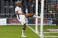 Andre Ayew of Swansea City vents his frustration kicking the away post after failing to score a goal during the Sky Bet Championship match between Swansea City and Wigan Athletic at the Liberty Stadium, Swansea, Wales, UK. Saturday 19 January 2020