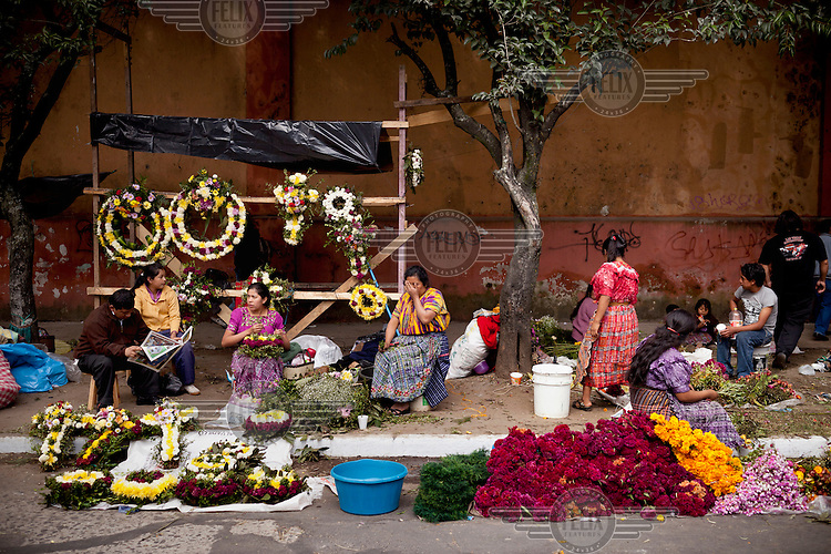 Flower venders outside Cementario General during Dia de los Muertos (The Day of the Dead).
