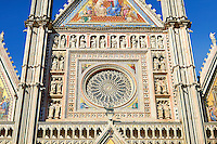 Close up of the rose window built by the sculptor and architect Orcagna between 1354 and 1380 on the14th century Tuscan Gothic style facade of the Cathedral of Orvieto, designed by Maitani, Umbria, Italy