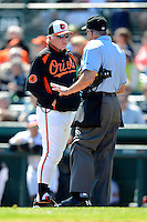 Baltimore Orioles manager Buck Showalter #26 talks with umpire John Hirschbeck during a Spring Training game against the Toronto Blue Jays at Ed Smith Stadium on March 7, 2013 in Sarasota, Florida.  Balitmore defeated Toronto 11-10.  (Mike Janes/Four Seam Images)