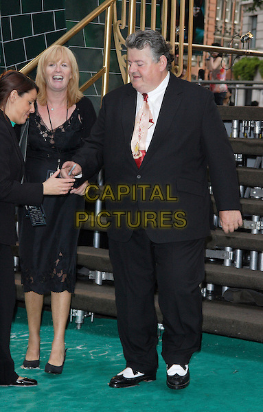 """ROBBIE COLTRANE .European Premiere of """"Harry Potter and the Order of the Phoenix"""" at the Odeon Leicester Square, London, England..July 3rd, 2007.full length suit signing autograph black .CAP/ROS.©Steve Ross/Capital Pictures"""