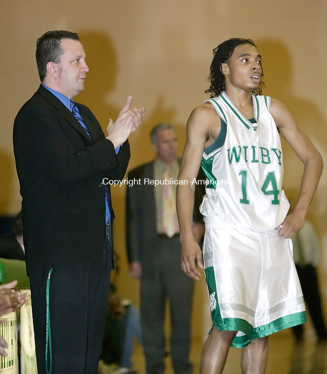 WATERBURY, CT. 14 FEBRUARY 2006-021406BZ13-  <br /> Wilby High interim head coach Steve Baldwin watches his team shoot free throws with Jordan Woolfolk (14) during their game against Holy Cross Tuesday night.<br /> Jamison C. Bazinet / Republican-American