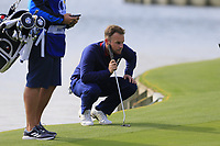 Tyrell Hatton Team Europe on the 18th green during Friday's Fourball Matches at the 2018 Ryder Cup, Le Golf National, Iles-de-France, France. 28/09/2018.<br /> Picture Eoin Clarke / Golffile.ie<br /> <br /> All photo usage must carry mandatory copyright credit (© Golffile | Eoin Clarke)
