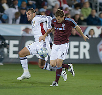 Colorado defender Jordan Harvey (red, 2) holds off Real Salt Lake forward Yura Movsisyan. Real Salt Lake earned a tied versus the Colorado Rapids securing a place in the postseason. Dick's Sporting Goods Park, Denver, Colorado, October, 25, 2008. Photo by Trent Davol/isiphotos.com