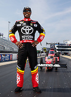 Sep 13, 2013; Charlotte, NC, USA; Toyota NHRA top fuel dragster and driver Antron Brown poses for a portrait prior to qualifying for the Carolina Nationals at zMax Dragway. Mandatory Credit: Mark J. Rebilas-USA TODAY Sports