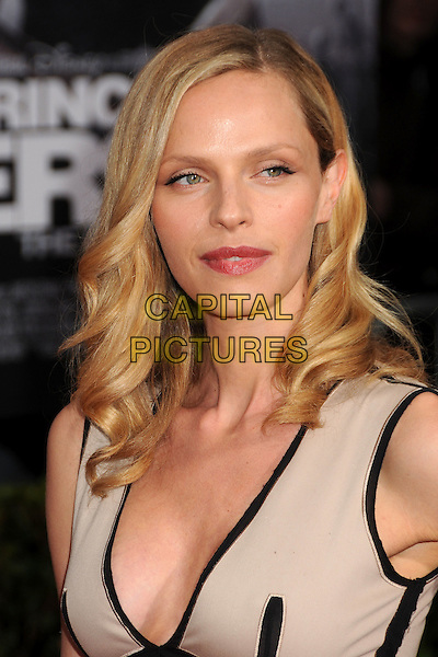 "RACHEL ROBERTS.""Prince Of Persia: The Sands Of Time"" Los Angeles Premiere held at Grauman's Chinese Theatre, Hollywood, California, USA..May 17th, 2010.headshot portrait black trim beige low cut neckline cleavage .CAP/ADM/BP.©Byron Purvis/AdMedia/Capital Pictures."