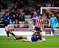 Crewe Alexandra's Ryan Wintle slides in on Lincoln City's Shay McCartan<br /> <br /> Photographer Andrew Vaughan/CameraSport<br /> <br /> The EFL Sky Bet League Two - Lincoln City v Crewe Alexandra - Saturday 6th October 2018 - Sincil Bank - Lincoln<br /> <br /> World Copyright &copy; 2018 CameraSport. All rights reserved. 43 Linden Ave. Countesthorpe. Leicester. England. LE8 5PG - Tel: +44 (0) 116 277 4147 - admin@camerasport.com - www.camerasport.com