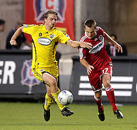 Columbus Crew midfielder Eddie Gavin (12) controls the ball in front of Chicago Fire midfielder Chris Rolfe (17).  The Chicago Fire tied the Columbus Crew 0-0 at Toyota Park in Bridgeview, IL on July 11, 2009.