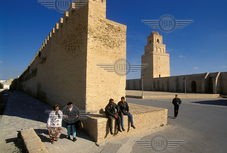 City walls surrounding the Medina, with the minaret of the Mosque of Sidi Oqba (The Great Mosque) visible behind.  The minaret, reconstructed in the 8th century, is the oldest minaret in North Africa..