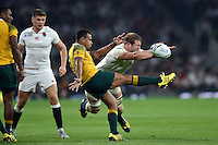 Will Genia of Australia has his box-kick charged down by Joe Launchbury of England. Rugby World Cup Pool A match between England and Australia on October 3, 2015 at Twickenham Stadium in London, England. Photo by: Patrick Khachfe / Onside Images