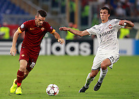 Calcio, Champions League, Gruppo E: Roma vs CSKA Mosca. Roma, stadio Olimpico, 17 settembre 2014.<br /> Roma midfielder Alessandro Florenzi, left, is challenged by CSKA Moskva midfielder Roman Eremenko, of Finland, during the Group E Champions League football match between AS Roma and CSKA Moskva at Rome's Olympic stadium, 17 September 2014.<br /> UPDATE IMAGES PRESS/Isabella Bonotto