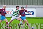 Listowel Celtic's Chris Mason and Spa Road FC's John Loughnane.