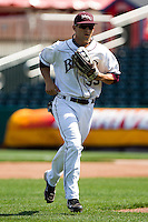 Spiker Helms (33) of the Missouri State Bears runs to the dugout during a game against the Wichita State Shockers on April 9, 2011 at Hammons Field in Springfield, Missouri.  Photo By David Welker/Four Seam Images