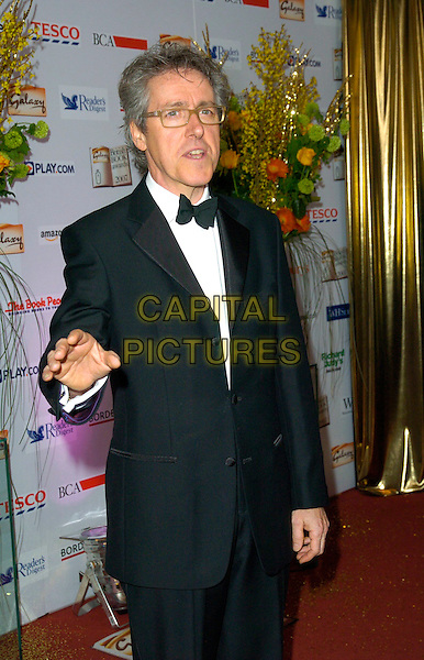GRIFF RHYS JONES.The Galaxy British Book Awards, Grosvenor House Hotel, London, England..March 28th, 2007.half length black tuxedo jacket glasses hand .CAP/CAN.©Can Nguyen/Capital Pictures