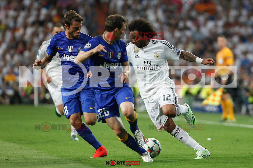 Real Madrid´s Marcelo Vieira (R) and Juventus´s Claudio Marchisio and Lichsteiner during the Champions League semi final soccer match between Real Madrid and Juventus at Santiago Bernabeu stadium in Madrid, Spain. May 13, 2015. (ALTERPHOTOS/Victor Blanco) /NortePhoto.COM