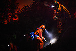 The McCain inmate crew struggles to cut a fire line on a steep slope on the Rim Fire near Buck Meadows, California, August 24, 2013. The Rim Fire burned 257,314 acres and is the third largest wildfire in California history.