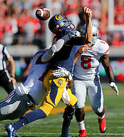 Ohio State Buckeyes linebacker Ryan Shazier (10) sacks California Golden Bears quarterback Jared Goff (16) forcing a fumble during the first quarter of the NCAA football game at Memorial Stadium in Berkeley, California on Sept. 14, 2013. (Adam Cairns / The Columbus Dispatch)