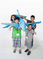 OrigamiUSA 2016 Convention at St. John's University, Queens, New York, USA. Oversized 9' x 9' paper folding event. First timers. Left to right: front - Noah Goodman, unknown, back - unknown, unknown.