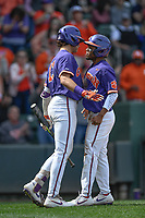 Second baseman Jordan Greene (9) of the Clemson Tigers, right, chest bumps with Bryce Teodosio (13) after scoring a run in the Reedy River Rivalry game against the South Carolina Gamecocks on Saturday, March 2, 2019, at Fluor Field at the West End in Greenville, South Carolina. Clemson won, 11-5. (Tom Priddy/Four Seam Images)