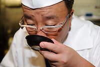 "Tamura Takashi owner of ""Tsukiji Tamura"" Japanese restaurant, tastes some freshly prepared dashi, Tokyo, Japan, July 17, 2009. Tsukiji Tamura is one of the best known ""ryotei"" traditional Japanese restaurants in Tokyo. Owner Tamura prepares dashi using two types of katsuobushi plus kombu from Hakodate in Hokkaido."