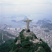 Rio de Janeiro, Brazil. The Statue of Christ the Redeemer on the Corcovado mountain with the Sugar Loaf beyond.
