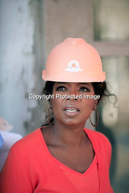 "JOHANNESBURG, SOUTH AFRICA AUGUST 10: Oprah Winfrey inspects the construction site of her school ""Oprah Winfrey Leadership Academy for Girls"" located about 40 miles south of Johannesburg in Henley-on-Klip, Meyerton. Oprah visited South Africa to interview girls and to inspect the construction of the school. (Photo by Per-Anders Pettersson)..."