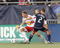 New York Red Bulls defender Jan Gunnar Solli (8) dribbles as New England Revolution defender Flo Lechner (2) defends. Despite a red-card man advantage, in a Major League Soccer (MLS) match, the New England Revolution tied New York Red Bulls, 1-1, at Gillette Stadium on September 22, 2012.
