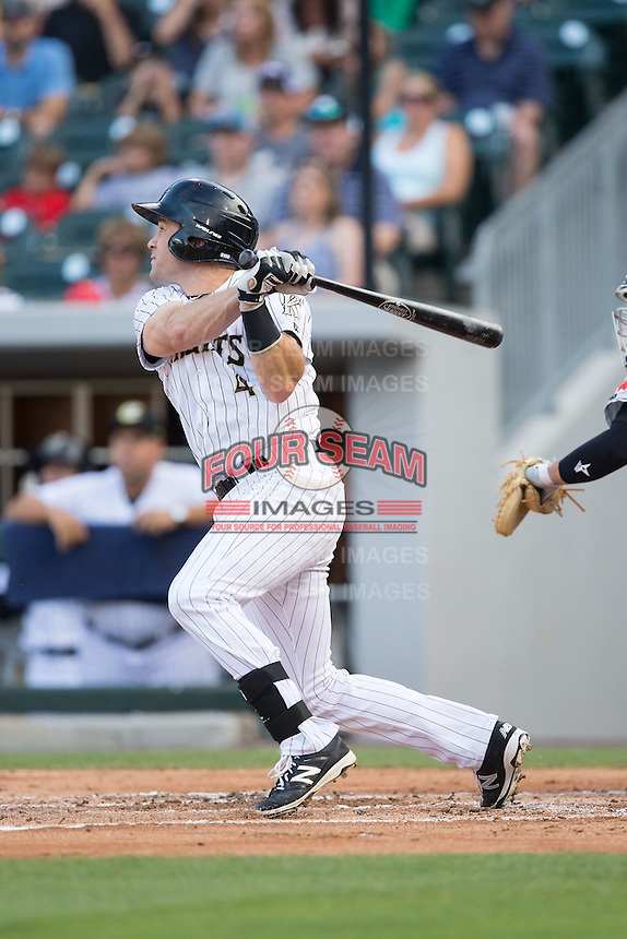 Vinny Rottino (4) of the Charlotte Knights follows through on his swing against the Indianapolis Indians at BB&T BallPark on June 17, 2016 in Charlotte, North Carolina.  The Knights defeated the Indians 4-0.  (Brian Westerholt/Four Seam Images)