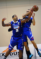 Benny Anthony Jr and Lndsay Tait in action during the national basketball league match between Wellington Saints and Canterbury Rams at TSB Bank Arena, Wellington, New Zealand on Friday, 13 June 2014. Photo: Dave Lintott / lintottphoto.co.nz