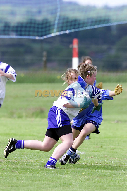 Monaghans No 5 Louise Cunningham being atacked by Dublin defence during the Dublin V Monaghan All Ireland U/14 Semi Final in Drumbarragh, Co Meath..Picture Fran Caffrey Newsfile.