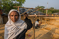 Bangladesh, Cox's Bazar. Kutupalong Rohingya Refugee Camp. The Rohingya, a Muslim ethnic group  denied citizenship in Burma/Myanmar have escaped persecution from Burmese militants in their country. There are up to 500,000 refugees and migrants living in makeshift camps in Cox's Bazar. Maleka Khatun, this elderly woman came here four months ago when her husband was killed by Bumese militants.Her family is building her a makeshift home.  Model released.
