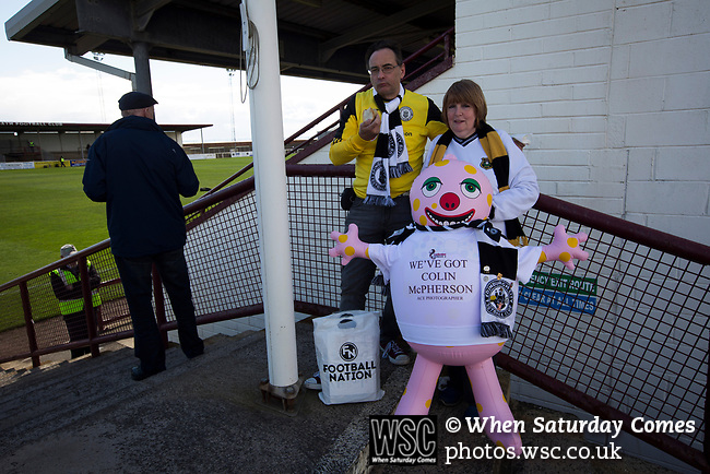 Arbroath 0 Edinburgh City 1, 15/03/2017. Gayfield Park, SPFL League 2. Two away fans with a Mr Blobby doll at Gayfield Park as Arbroath hosted Edinburgh City (in yellow) in an SPFL League 2 fixture. The newly-promoted side from the Capital were looking to secure their place in SPFL League 2 after promotion from the Lowland League the previous season. They won the match 1-0 with an injury time goal watched by 775 spectators to keep them 4 points clear of bottom spot with three further games to play. Photo by Colin McPherson.