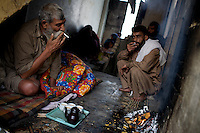 A man worshipped  by the local heroin addict community as a healer receives tea and cigarettes  as gifts on the second floor of a depot in front of a Mosque  in the city of Rawalpindi, Pakistan on Thursday November 27 2008.///..While Bangladesh, India, Nepal and Maldives all suffer from drug consumption, Pakistan is the worst victim of the drug trade in South Asia. Today, the country has the largest heroin consumer market in the south-west Asia region..The drug addicts resort to crime for generating income for the purchase of narcotics. The situation is becoming serious due to the number of heroin addicts in the country. An alarming rate of increase of 100,000 addicts per year is highly dangerous to society. The drug addicts are affecting nearly 20 million dependents and family members with psychological, social, and economic repercussions.