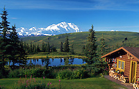 Log cabin at Camp Denali, Alaska, with Mt. McKinley in background
