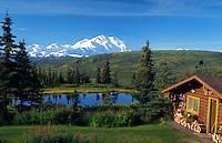 Log cabin at Camp Denali, Alaska, with Mt. McKinley in background