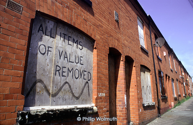 A street of boarded up houses scheduled for demolition, Lower Broughton, Salford. Unemployment and consequent population decline have left unpopular streets empty and an easy target for vandals.