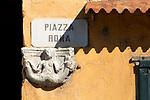 A detail of an old stone sign of a mermaid in Tremezzo, a town on Lake Como, Italy