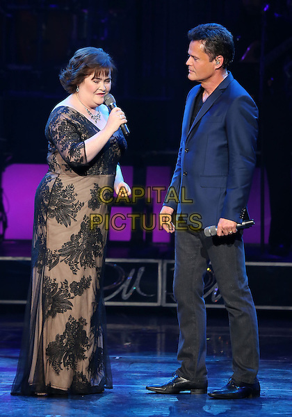 Susan Boyle & Donny Osmond.Susan Boyle Performs With Donny Osmond at Donny & Marie Show at Flamingo Las Vegas,  Las Vegas, Nevada, USA..October 17th, 2012.on stage in concert live gig performance performing music full length blue suit jacket singing black trousers grey gray lace dress side profile    .CAP/ADM/MJT.© MJT/AdMedia/Capital Pictures.