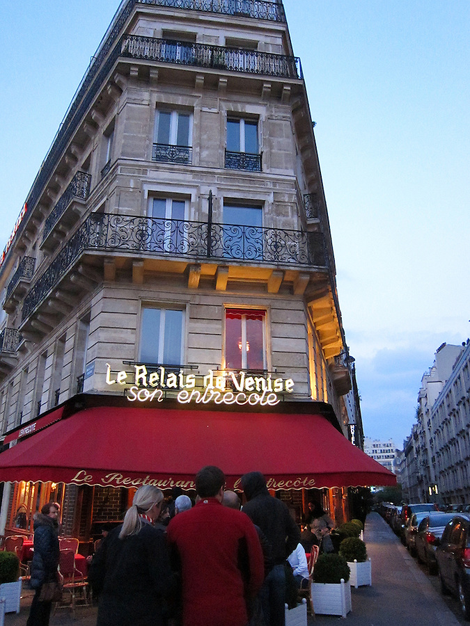 People waiting in line at Le Relais de Venise, a popular restaurant in Paris, France