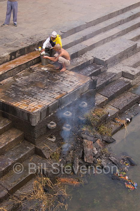 A Hindu cremation at a temple in Kathmandu Nepal.