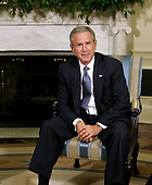 United States President George W. Bush poses for photographers in the Oval Office at the White House September 6, 2005 in Washington, DC. President Bush spoke about efforts to assist students and school districts in the Gulf Coast states who were displaced by Hurricane Katrina.  <br /> Credit: Chip Somodevilla / Pool via CNP